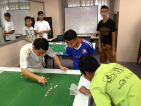 Michael Choong (in white), attempting a shot against Anas
